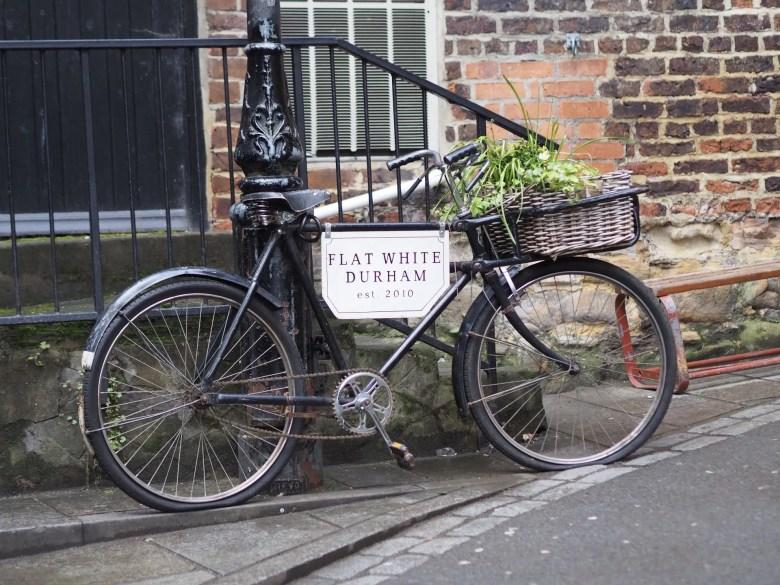 black bicycle advertising flat white cafe Durham