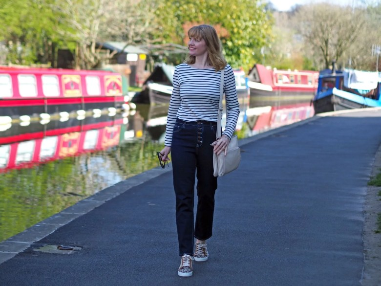 striped top and button fly jeans outfit