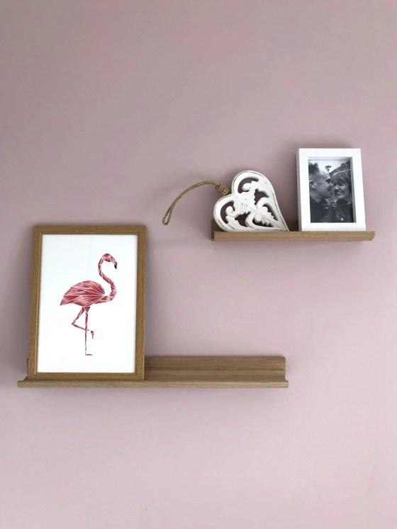 oak picture ledges with prints on