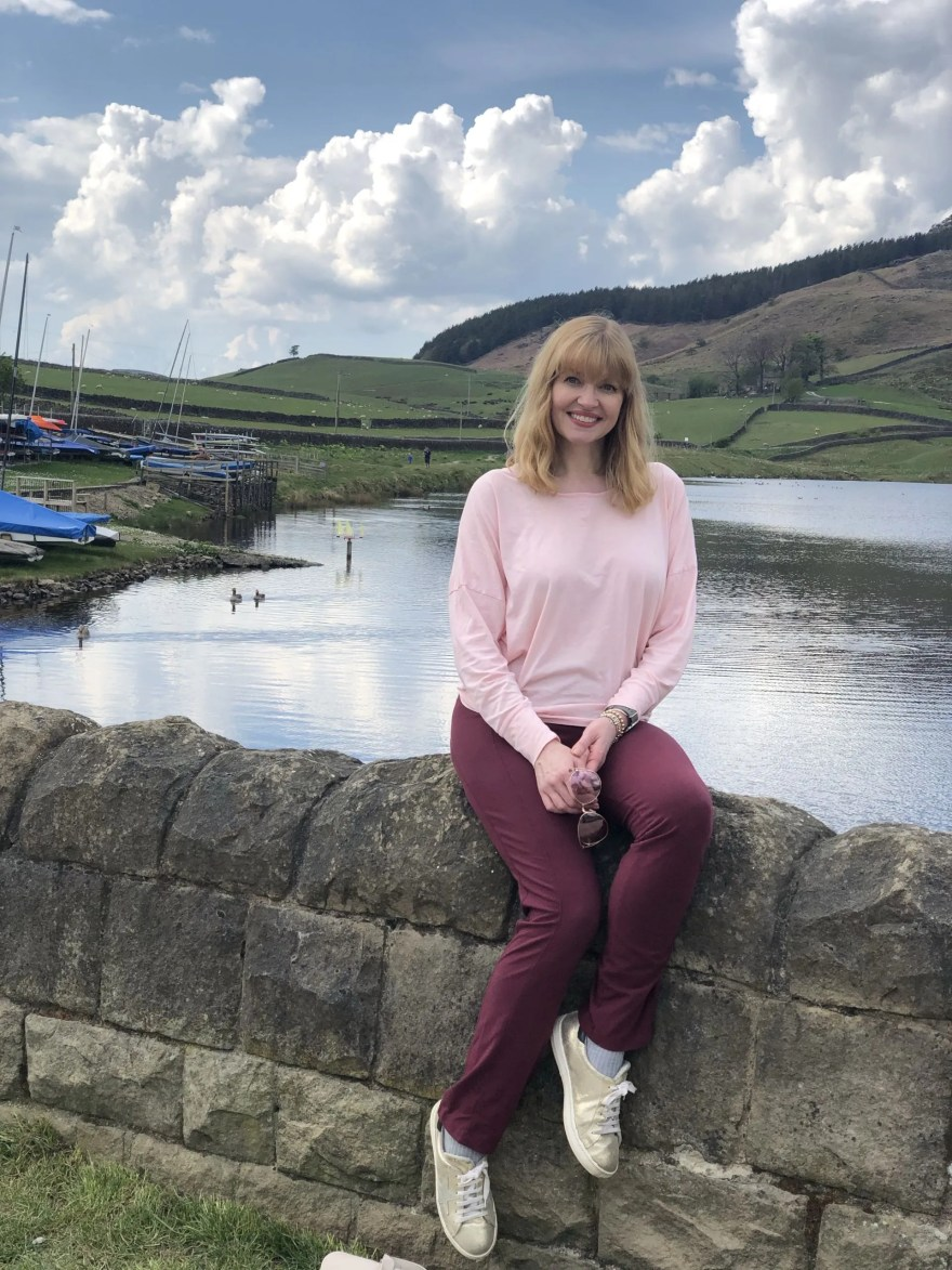 woman sitting on wall at Embsay reservoir