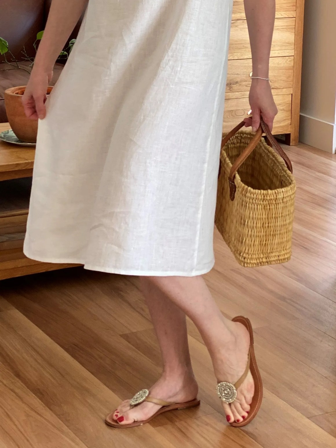 white linen dress and beaded sandals