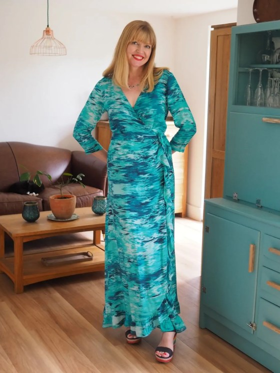 woman wearing aqua ruffle maxi dress