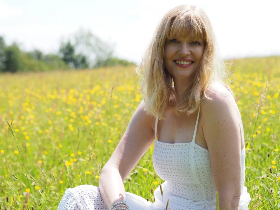 woman in wildflower meadow