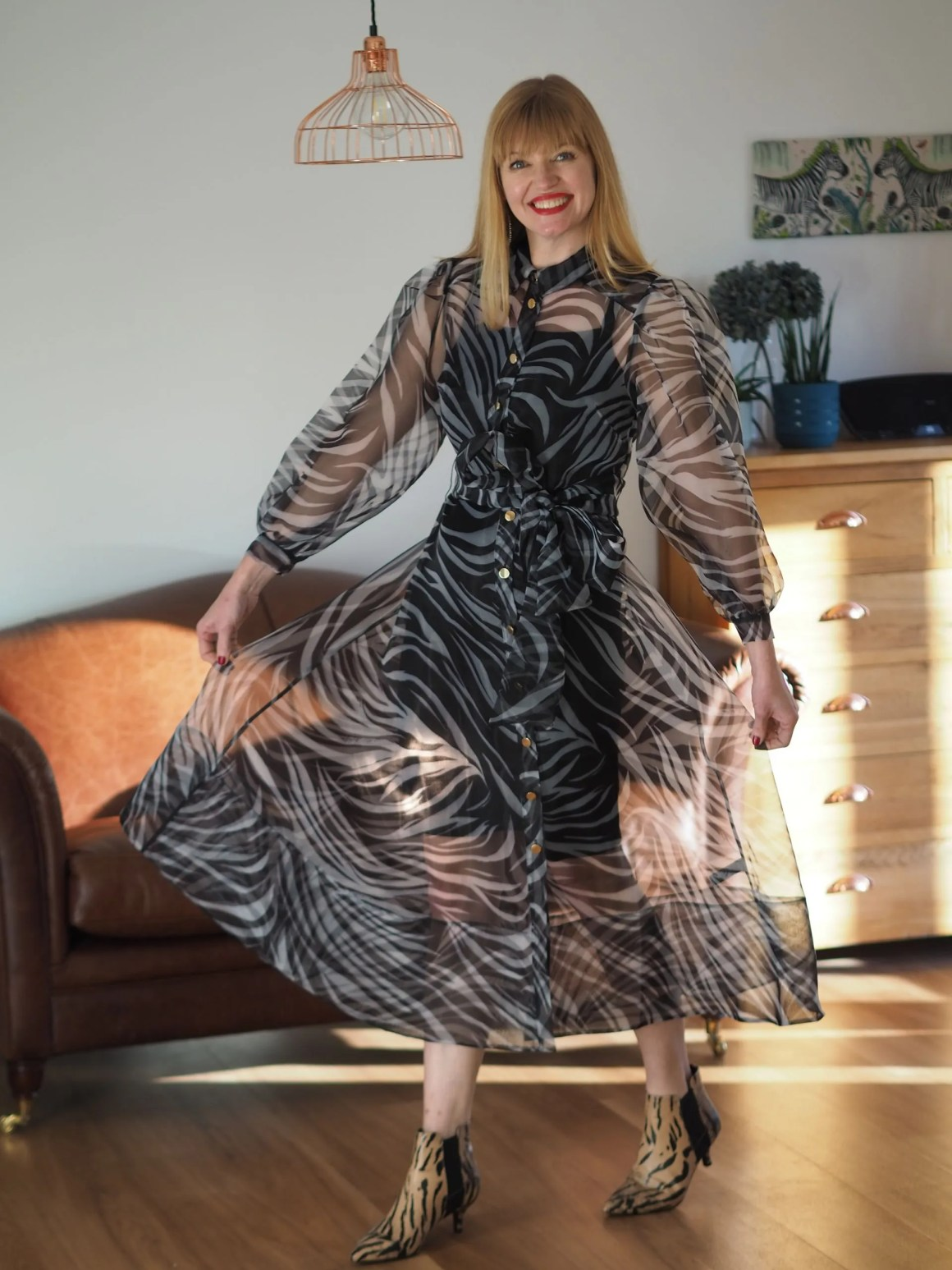 zebra print midi dress with tiger print ankle boots