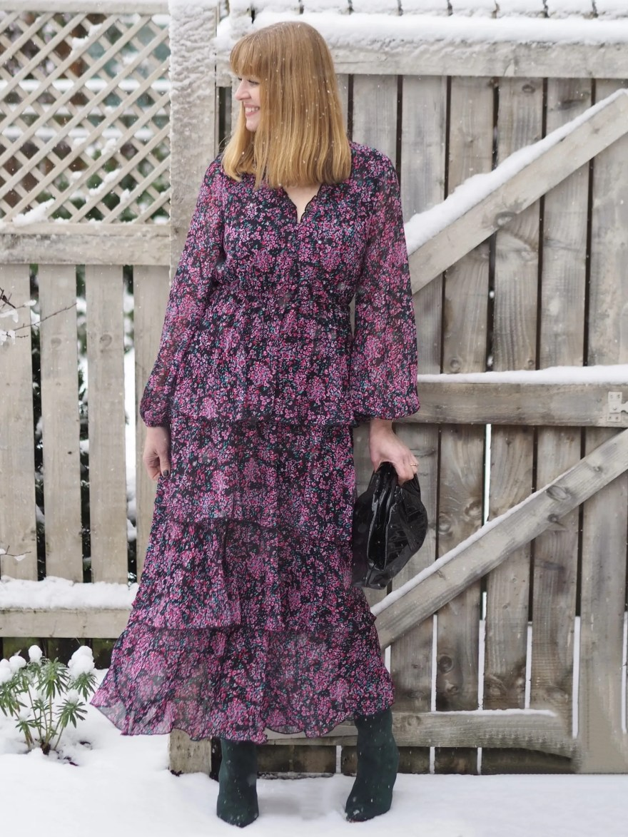 woman wearing dark floral tiered maxi dress