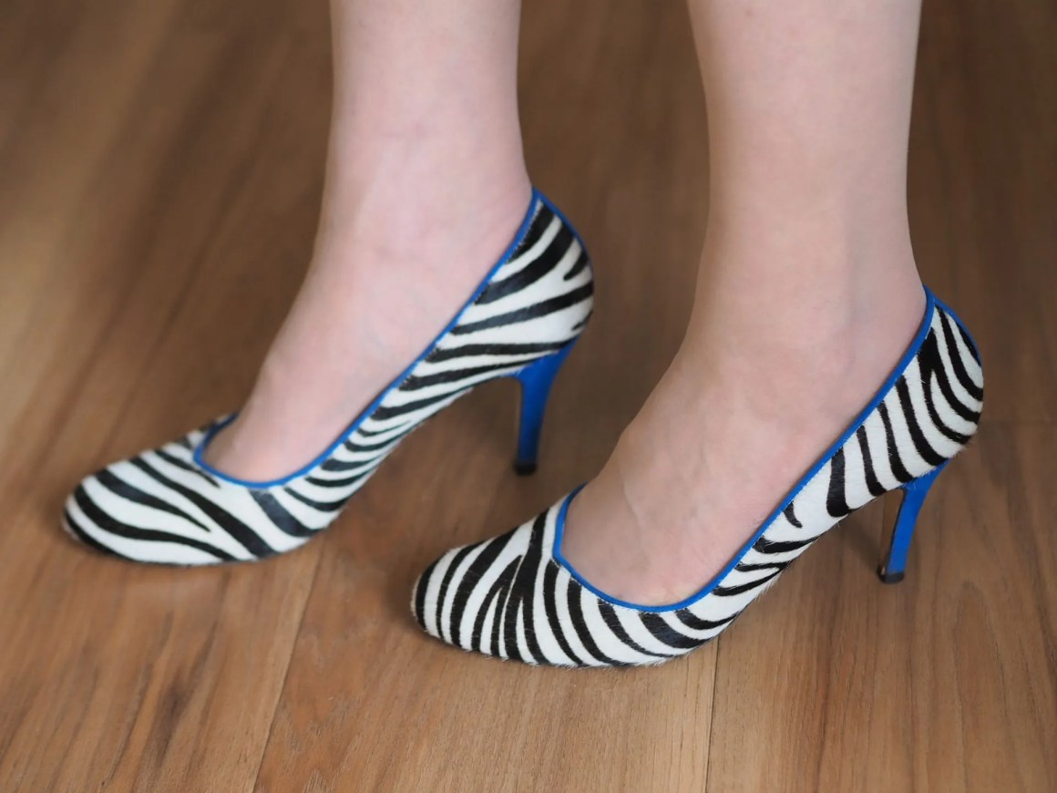 black and white zebra shoes with contrasting cobalt blue heels