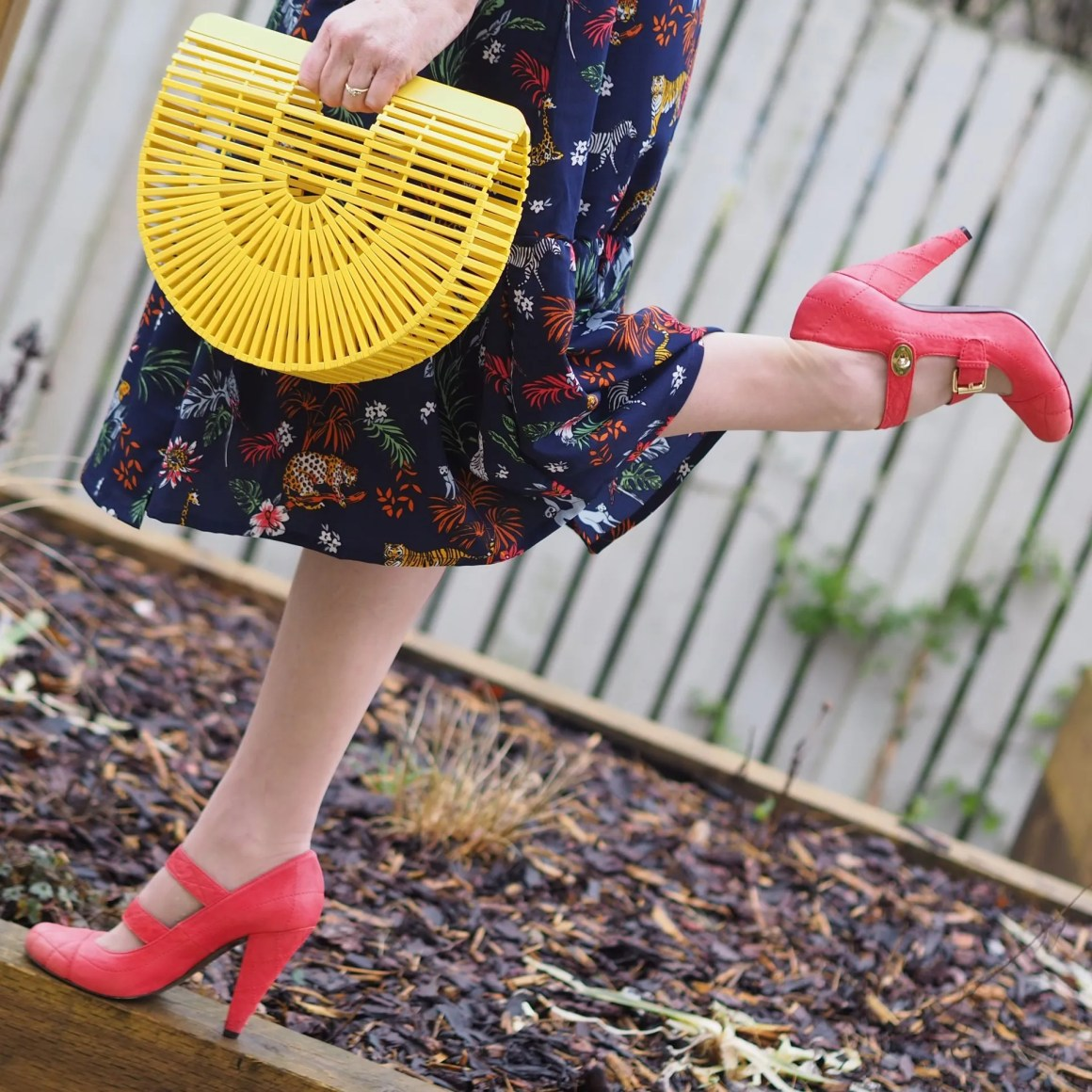 yellow wooden bag and orange shoes
