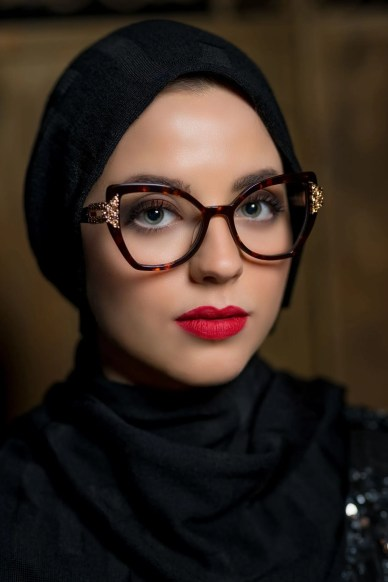 Model wears Aurora by Pier Martino cat eye glasses set with Swarovski crystals