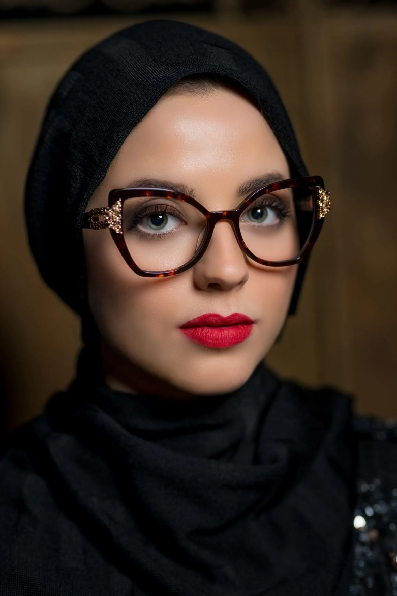 Model wears Aurora by Pier Martino cat eye glasses set with Swarovski crystals