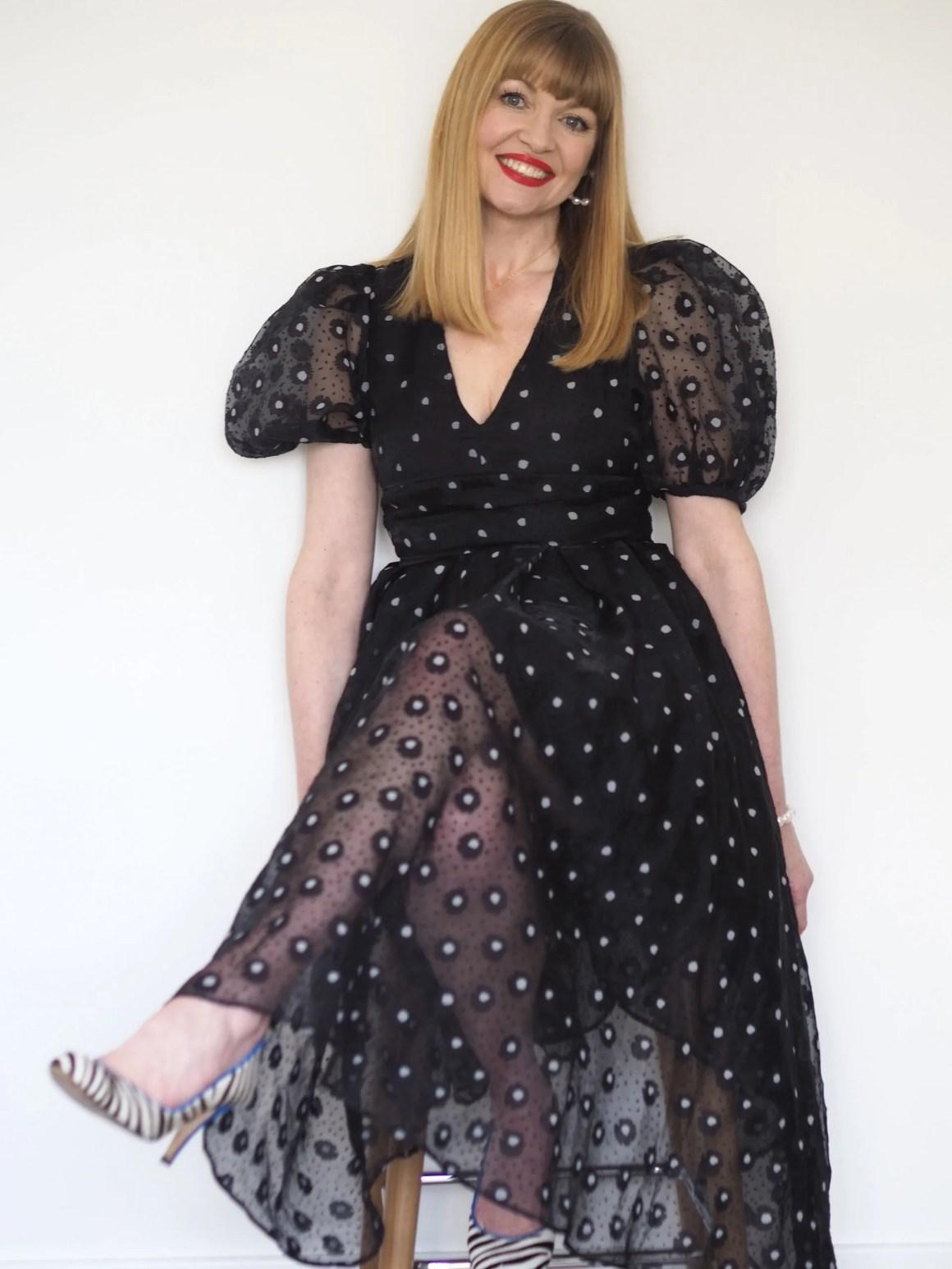 black puff sleeve dress with zebra shoes