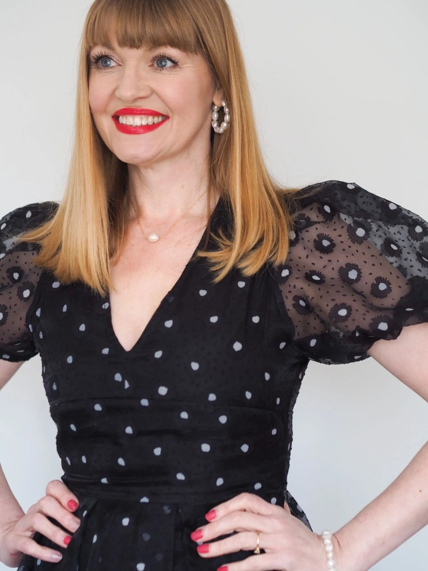 black puff sleeve dress with freshwater pearl jewellery