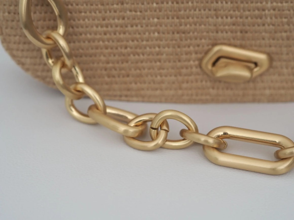 matte gold chain and toggle fastening on designer handbag