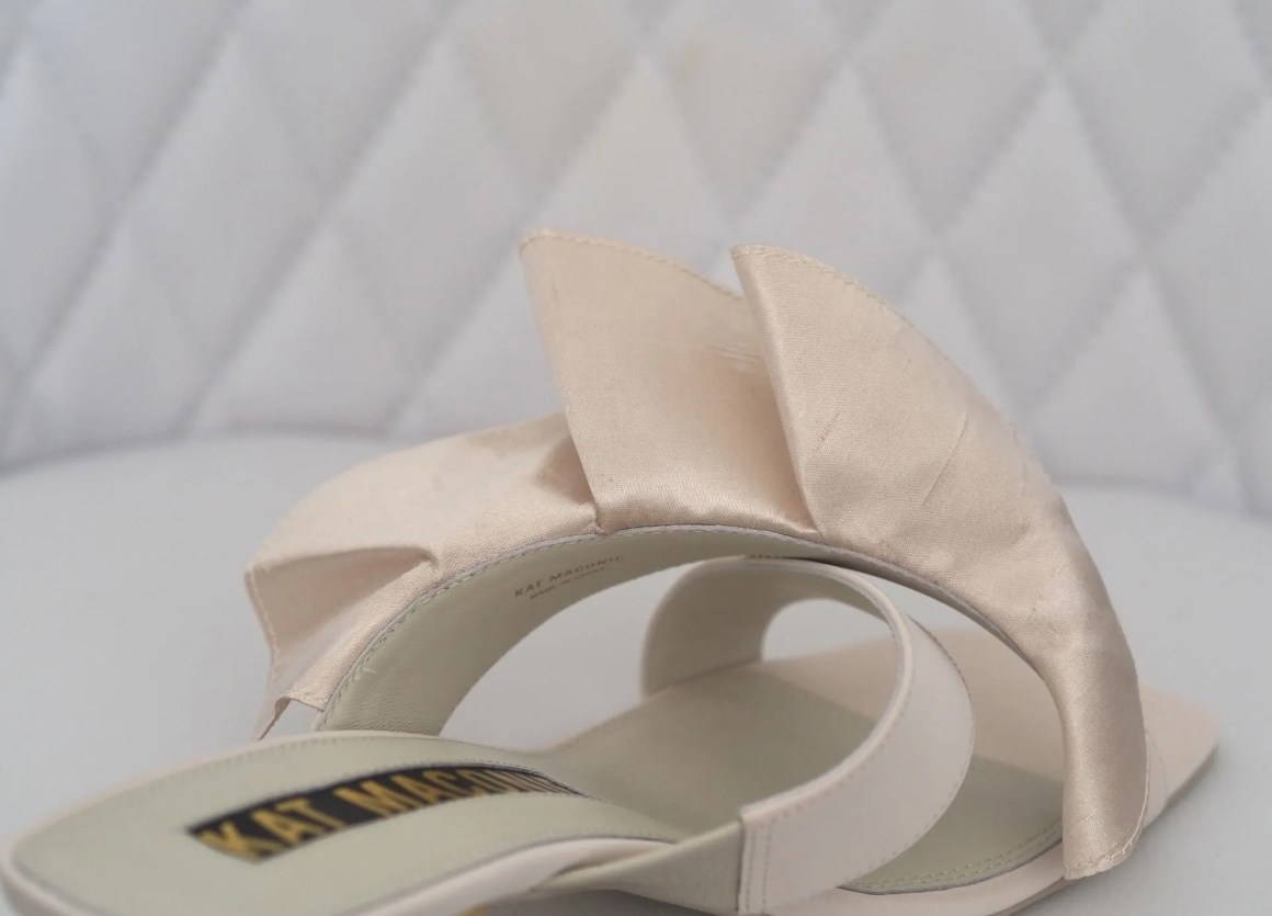 satin detail on pearly pink mules