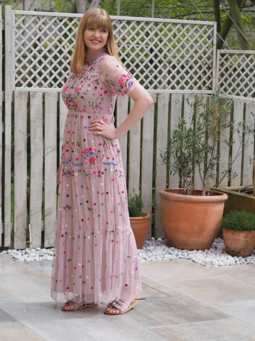 nude pink embroidered maxi dress with flat sandals