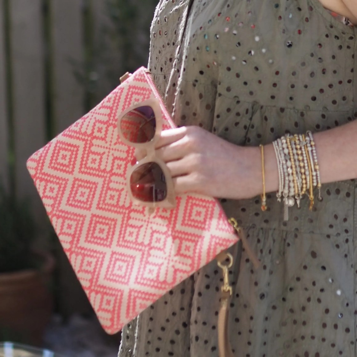 coral clutch bag and Aspinal Riviera sunglasses