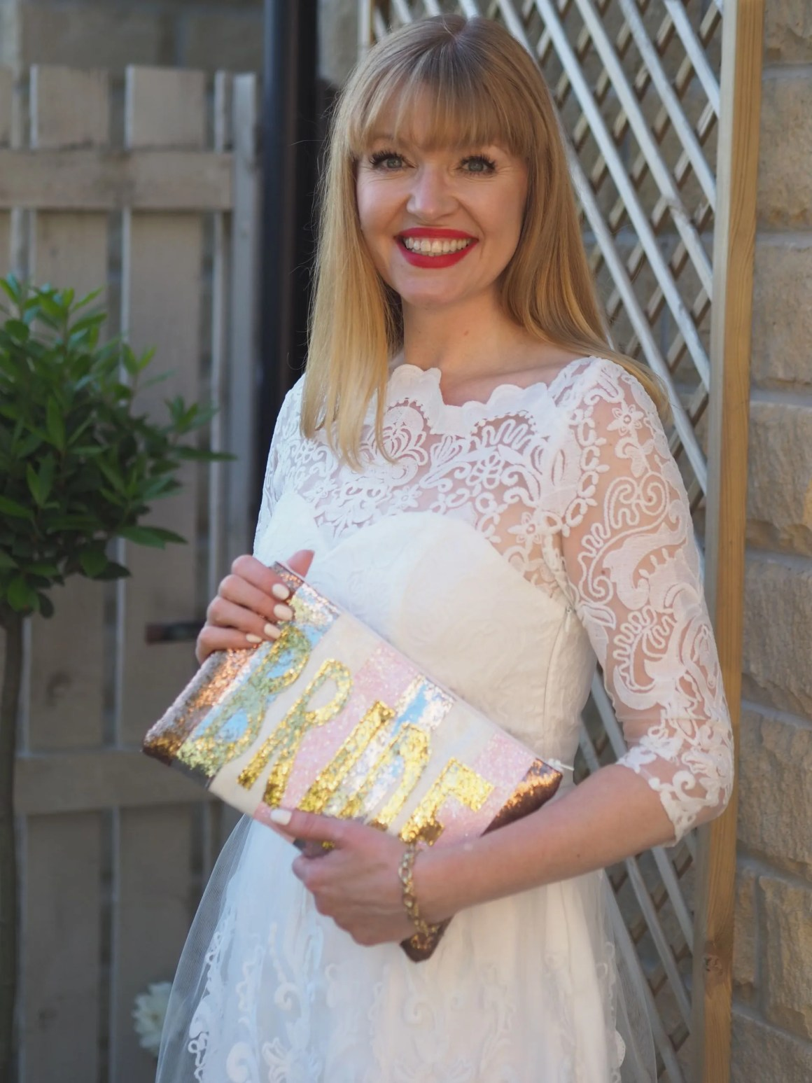 short white lace wedding dress with glitter bride clutch bag