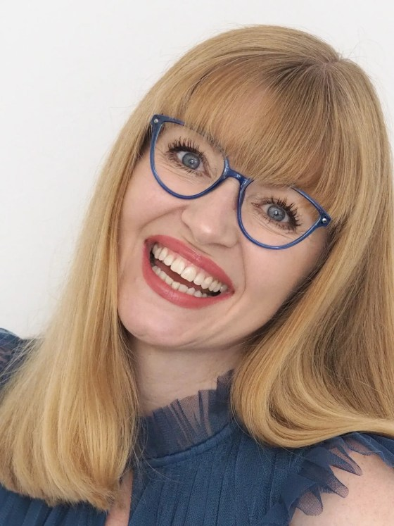 woman wears blue lightweight cat eye eyewear