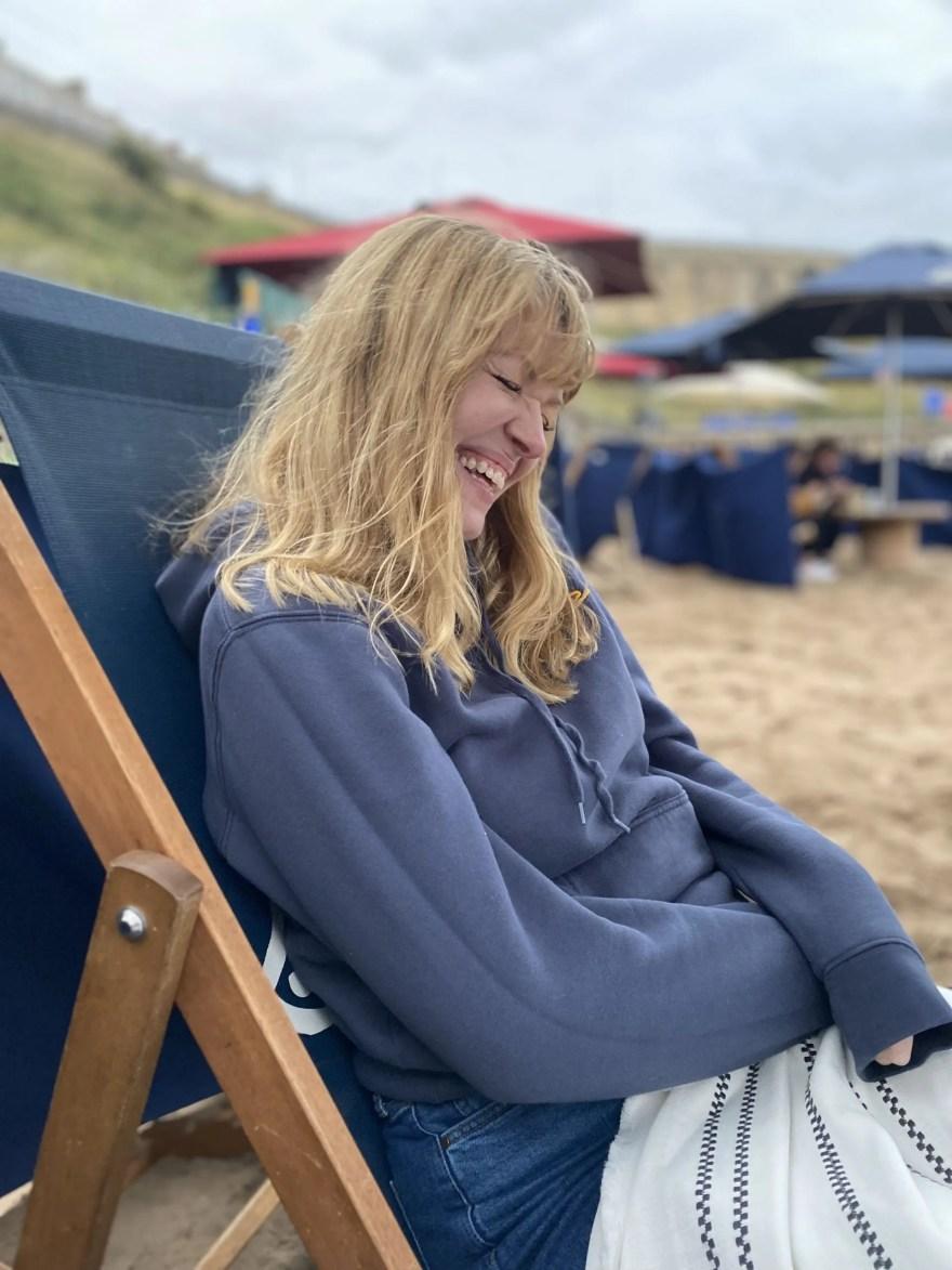 Elizabeth wears frozen surf society hoodie
