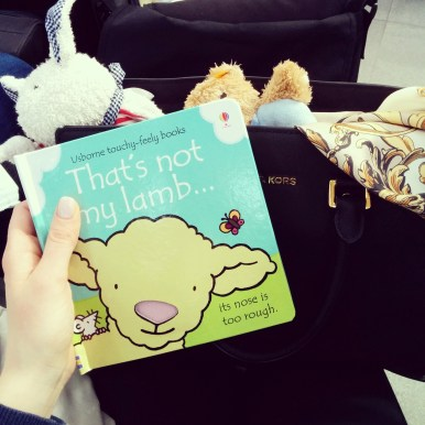 At the airport: my bag full of toys, I guess that's what traveling with a baby looks like :)