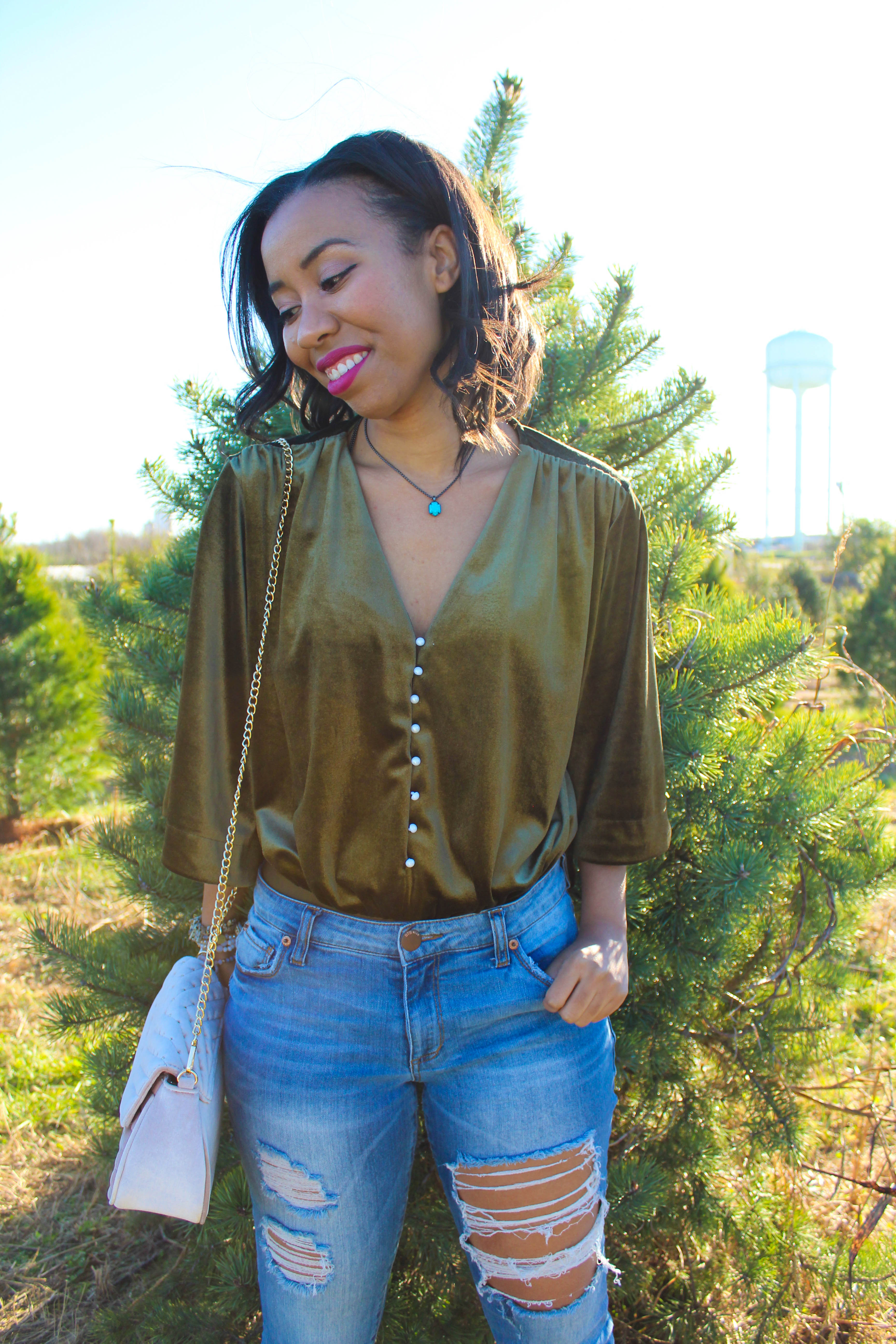 A casual velvet outfit for the fall to winter transition plus tips for dealing with the holiday blues and practicing self-care on a budget from southern lifestyle blogger, What Nicole Wore. // bodysuit outfit inspiration, velvet bodysuit for winter, distressed jeans outfit, kendra scott teo necklace, kendra scott color bar necklace, tom ford lipstick
