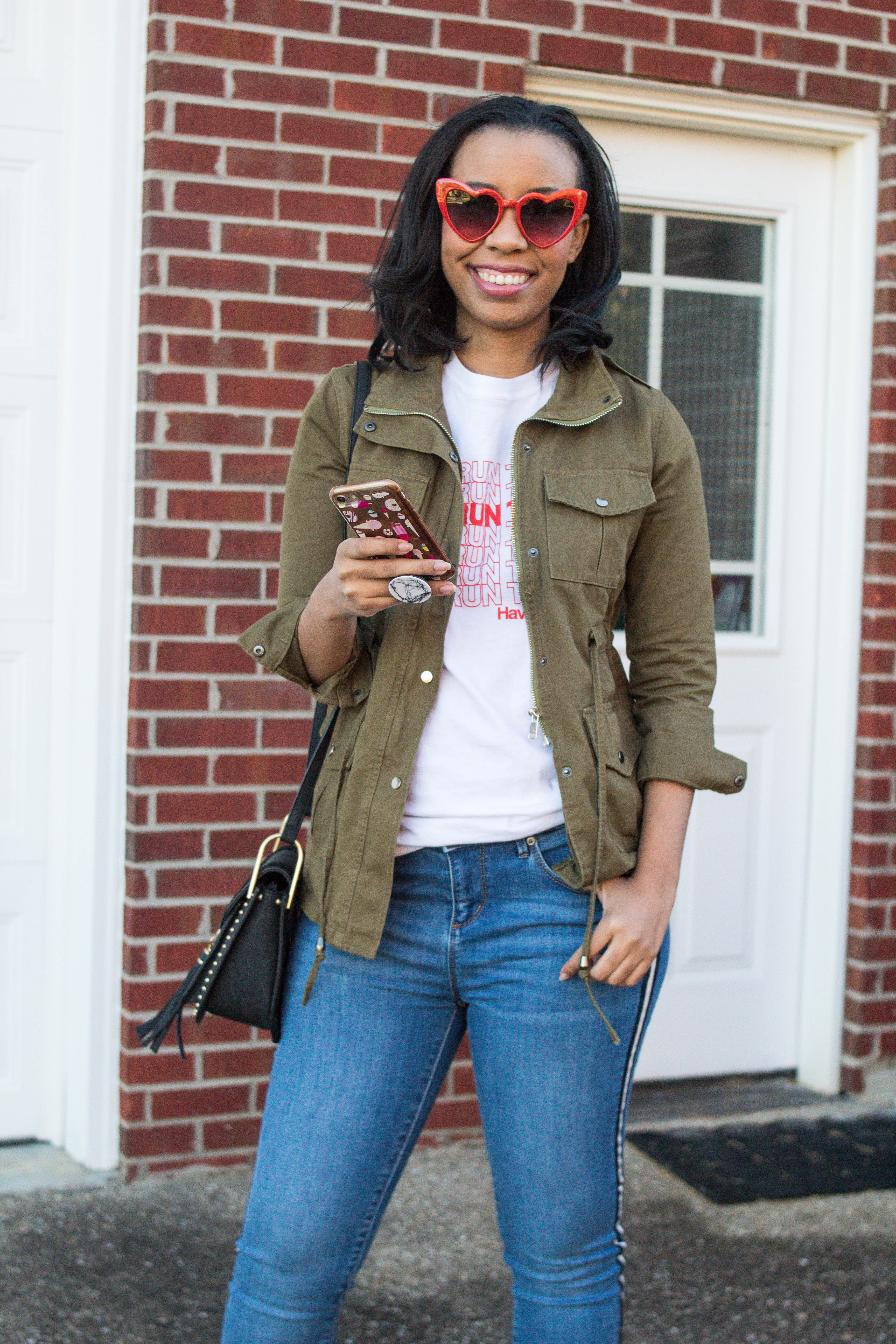 Popular style blogger, What Nicole Wore, shows how to take ten wardrobe staples and create twenty fall outfits with a fall capsule wardrobe. // heart sunglasses, designer dupe sunglasses, gordmans clothing finds, utility jacket outfits, graphic tee styling inspiration