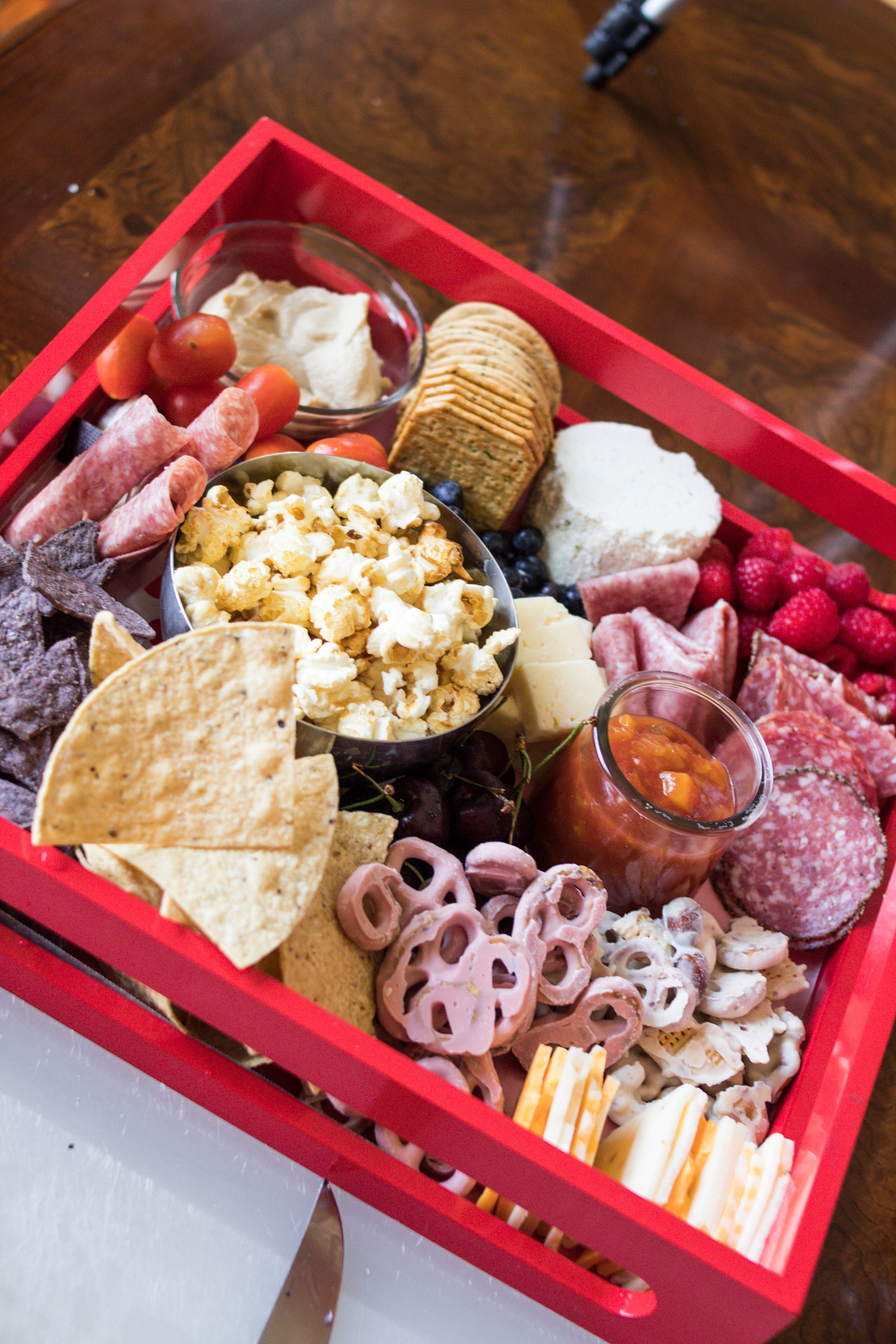 Grazing boards are all the rage right now! Lifestyle blogger, What Nicole Wore, takes you through how to assemble the best charcuterie board. // salami appetizer, appetizer board, charcuterie board tips, grazing board ideas, cheese and crackers