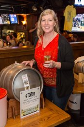 Monica Frost with her beer brewed at Storm