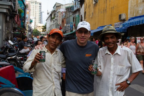 Pedal Taxi driver and friend enjoy the first cans of Red Racer IPA to be cracked in Saigon, South Vietnam, 2011. With Rick Green