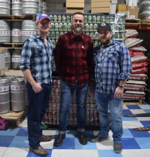 Arnold Tobler, Jack Bensley and Travis Keyworth at Farm Country Brewing on opening day