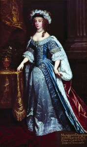Oil portrait of Margaret Cavendish. She wears an elaborate blue gown, tight at the waist with large hooped skirt, a fur and burgundy velvet cape cascading from the gown's wide shoulders. Her hair is in brown ringlets and she wears an unusual white circular cap that is possibly made of feathers.