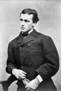 A man in high buttoned coat and high collar and tie stares pensively to the left.