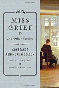 The cover of Miss Grief features a paining of a woman seated looking out a window, wearing a dark dress and with her hair up. She is painted from behind as if observed from across the room.