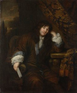 A man in 17th century dress, golden brown suit, white lace ruffs and cravat, long curly hair, clean-shaven face sits on a damask drape leaning his head on his hand and looking at the viewer with a pleasant expression.
