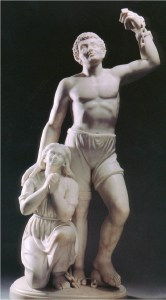 A marble statue in Neo-Classical style of a woman with clasped hands on her knees next to a man in draped shorts reaching upwards with loosed chains