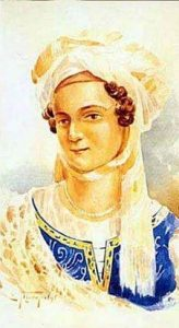 Bouboulina in dainty blue dress and white lace headscarf
