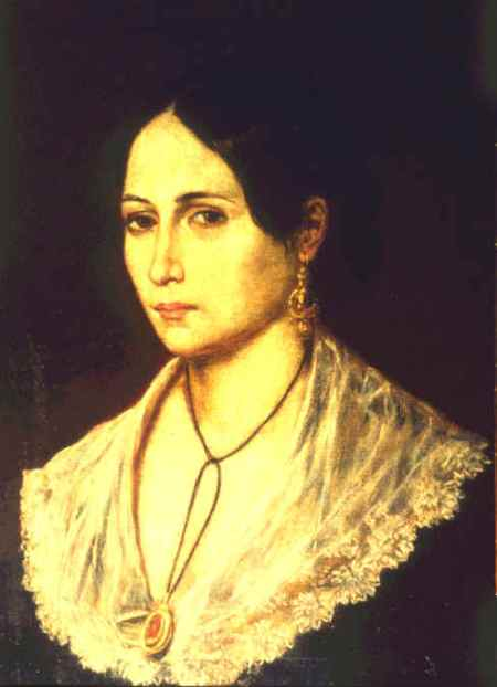 Portrait of Anita Garibaldi. She wears a black gown with wide white collar, dangly gold earrings and gold and red pendant necklace.