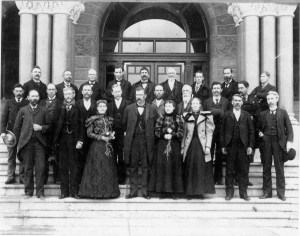 A group of men and three women stand on the steps of the Utah Capitol building