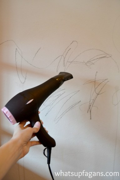 Cleaning crayons off walls with blow dryer