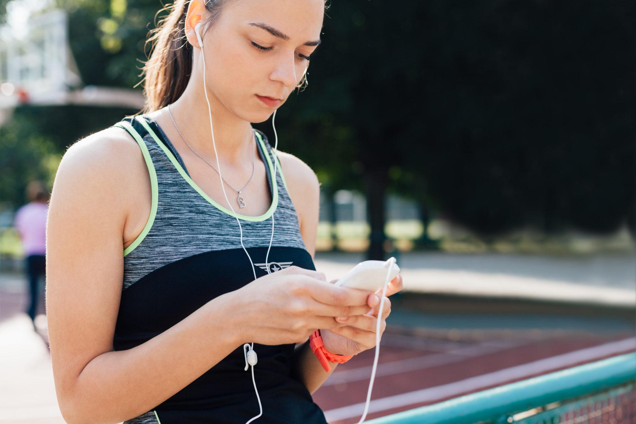 Girl choosing music for Exercise