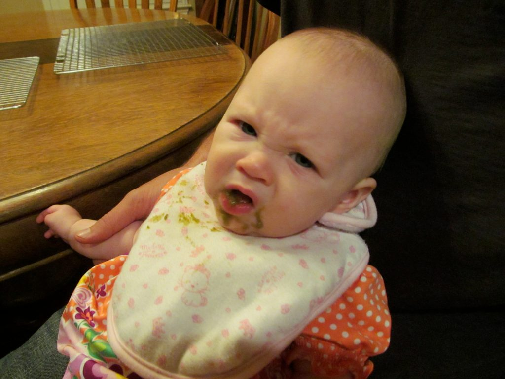 baby not liking baby food and making a face - when to introduce sippy cups to baby
