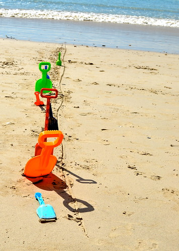 beach musical chairs is a fun beach game for kids even if you don't have beach chairs to use