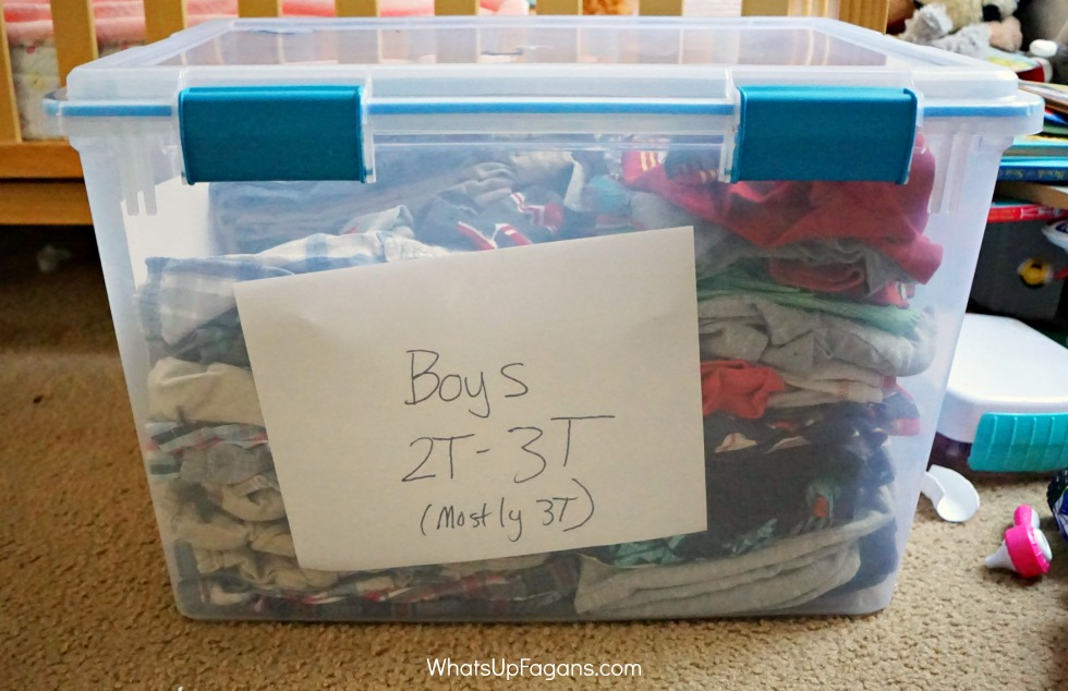 baby clothes storage bin filled with boy 2T-3T baby clothing in a plastic container with snaps on the lids for better storage solutions