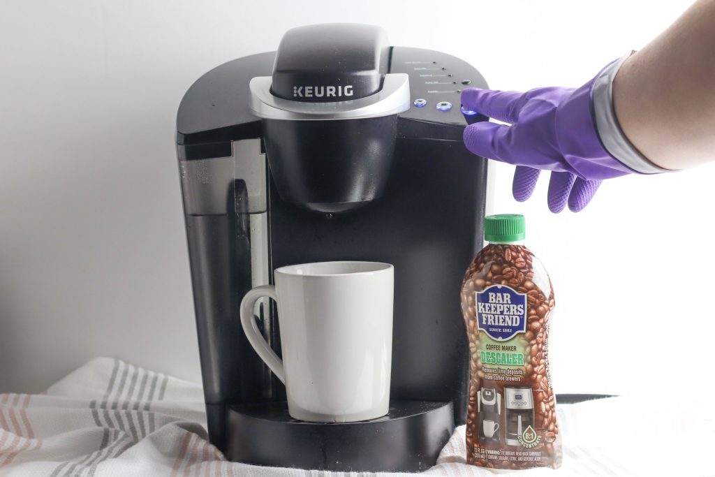 Running a brew cycle in order to clean Keurig coffee maker without vinegar
