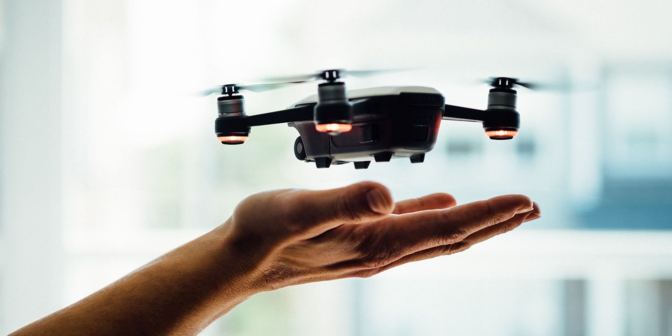 Drone lifting off from someone's hand