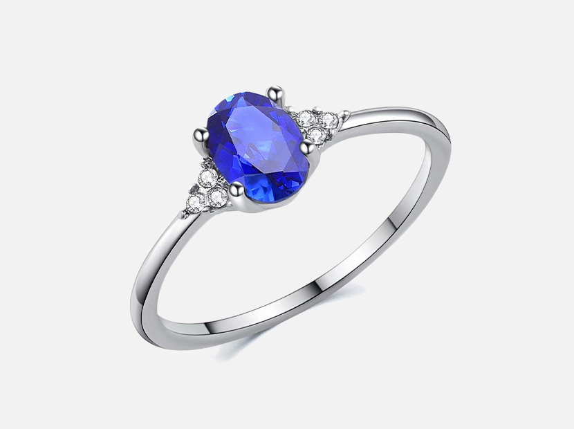 SR Sterling Silver Oval 0.9ct Created Sapphire Solitaire Style Engagement Ring.