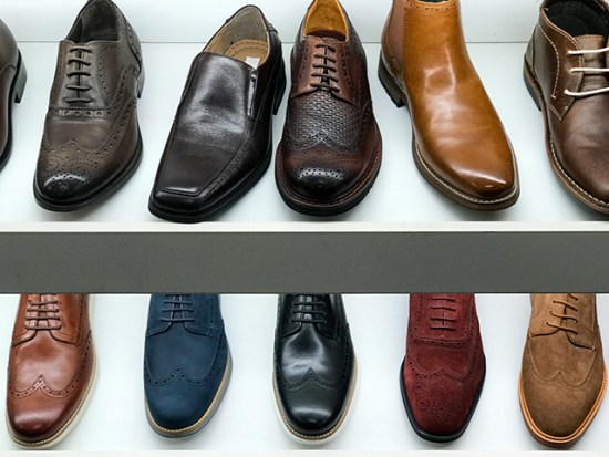 A row of men's shoes in a shoe store.