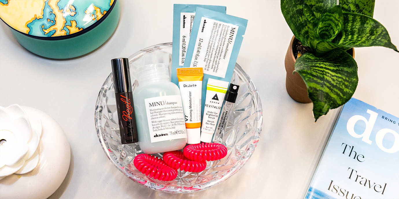 Birchbox products in a glass bowl arranged.
