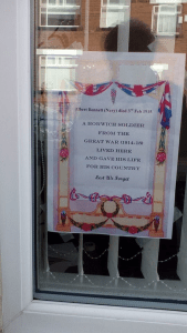 Commemorative Poster for Albert Bennett in the window of his former home in Horwich (Image courtesy of Carole Wright whose son now owns the property)