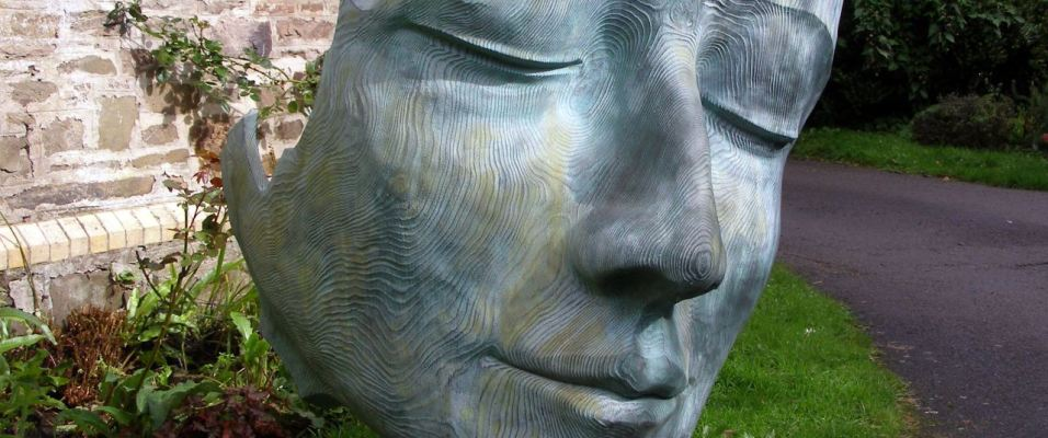 Sculpted face at Broomhill sculpture gardens, North Devon