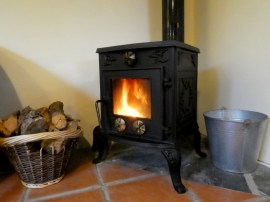 Woodburner, Otter Cottage, Wheatland Farm Eco Lodges in Devon